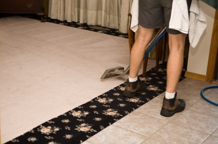 Pristine Cleaning Service technician cleaning carpet via hot water extraction in Estell Manor NJ.
